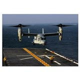 A V22 Osprey aircraft landing on the flight deck t