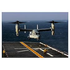 A V22 Osprey aircraft landing on the flight deck t