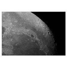 Close up view of the moon showing impact crater Pl
