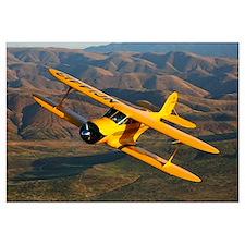 A Beechcraft D 17 Staggerwing in flight