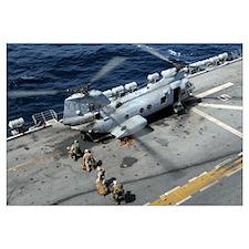 U.S. Marines board a CH 46 Sea Knight helicopter o