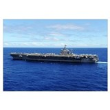 The aircraft carrier USS Abraham Lincoln transits