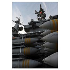 Stacked ordnance ready to be loaded aboard USS Joh