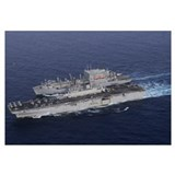 USS Kearsarge pulls alongside USNS Lewis and Clark