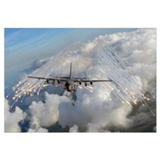 An AC 130U gunship jettisons flares over Florida