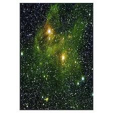 Two extremely bright stars illuminate a greenish m