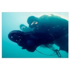 U.S. Navy SEAL combat swimmer pair navigate the wa