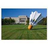 Gaint shuttlecock sculpture in front of a museum,