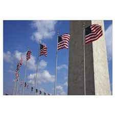 American flags in front of an obelisk Washington M