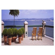 Chairs and potted plants on a deck, Monterey Bay,