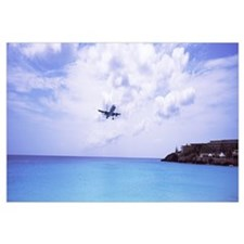 Airplane flying over the sea, Princess Juliana Int
