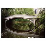 Arch bridge across a lake Central Park Manhattan N