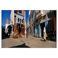 Four people walking on the street, Medina, Kairwan