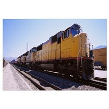 Freight train on railroad tracks, California