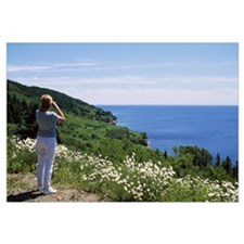 Woman whale-watching, Bay of Gaspe, Quebec, Canada