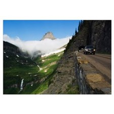 Cars on Going to the Sun Road through mountainside