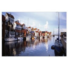 Sweden, Bohuslan, Smogen, Boat moored at the dock