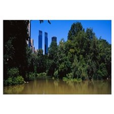 Reflection of trees in a pond, Central Park, Manha