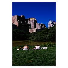 Tourists sitting on grass, Central Park, Manhattan