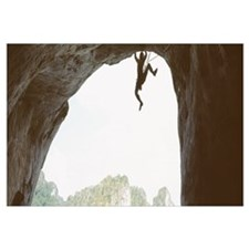 Silhouette of a man climbing a rock, Railay beach,