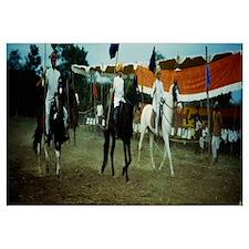Three Men On Horseback Riding In Front Of Spectato
