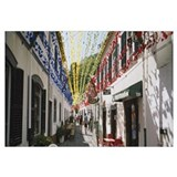 Multi-colored streamers hanging over a street, Sao
