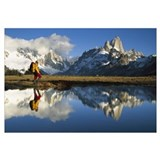 Hiker, Cerro Torre and Fitzroy reflected in small
