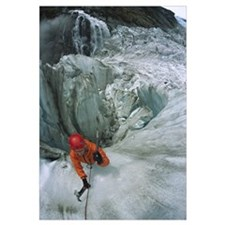 Ice climber on steep ice in Fox Glacier crevasse,