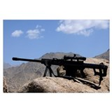 A Barrett .50-caliber M107 Sniper Rifle sits atop