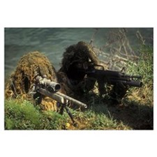 A SEAL Sniper swim pair set up an observation post