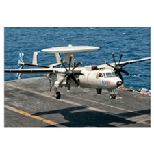 A US Navy E-2C Hawkeye prepares to land aboard USS