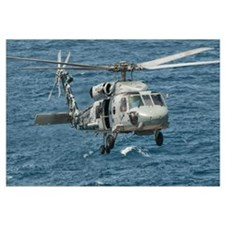 A US Navy SH-60F Seahawk flying off the coast of P