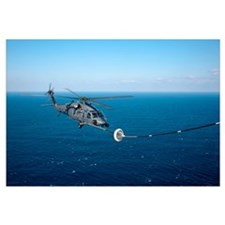 An HH-60 Pave Hawk refuels over the Pacific Ocean