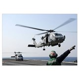 An HH-60H Sea Hawk helicopter takes off from USS R