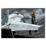 Flight deck crew position an F/A-18E Super Hornet