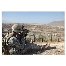 U.S Army soldier scans his sector of fire with his