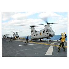 Ground crew prepares CH-46E Sea Knight helicopters