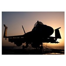 Silhouette of a US Navy F/A-18E Super Hornet on th