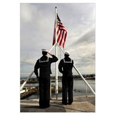 Sailors raise the national ensign aboard USS Abrah