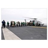 Sailors and Marines load supplies onto a HH-60H Se