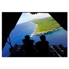 Loadmasters look out over Tumon Bay from a C-130 H