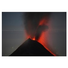 Nighttime lava eruption of Fuego volcano, Antigua,