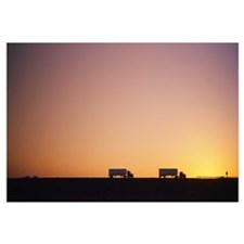Silhouette of two trucks moving on a highway, Inte