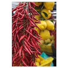 Close-up of bunches of chilli peppers and lemons h
