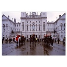 Black horse guards in front of a building, London,