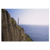 Lighthouse on a rocky coast, Cape Spear, Newfoundl