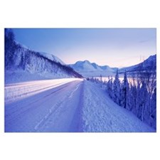 Highway running through a snow covered landscape,