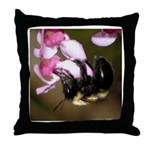 Bee dangling from Judas-tree flowers Throw Pillow