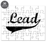 2-lead-blk.png Puzzle