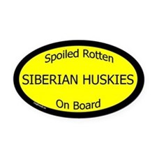 Spoiled Siberian Huskies On Board Oval Car Magnet